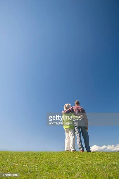 Embraced couple looking at the blue sky