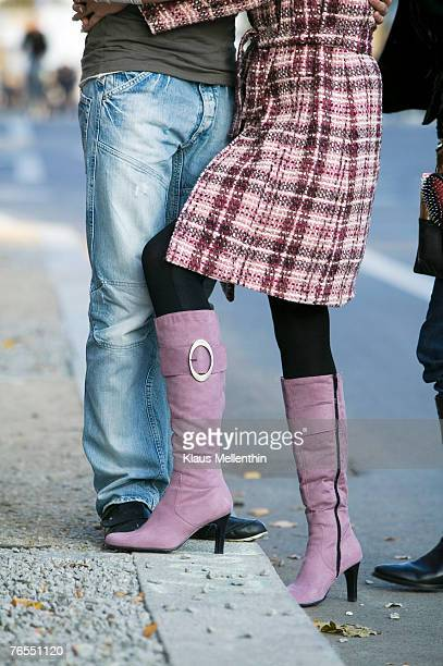Germany, couple embracing in street, low section