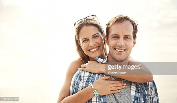 embracing each other under the sun - mid adult stock pictures, royalty-free photos & images