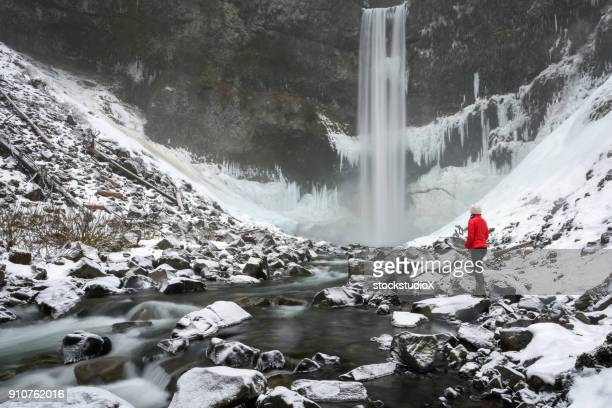 embracing natures beauty - red jacket stock pictures, royalty-free photos & images