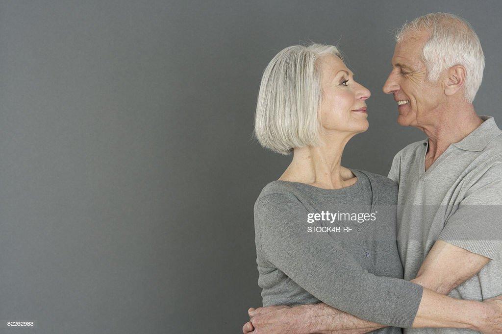 Embracing senior couple : Stock Photo