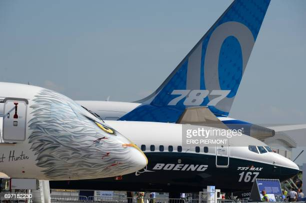 Embraer and Boeing jetliners stand on the Tarmac of Le Bourget on June 18 2017 on the eve of the opening of the International Paris Air Show