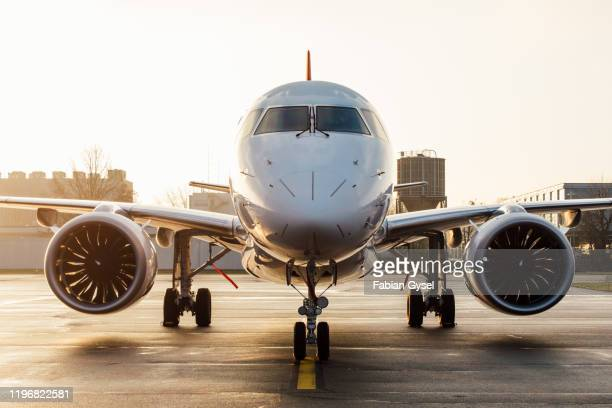 embraer e190-e2 - boeing stock pictures, royalty-free photos & images