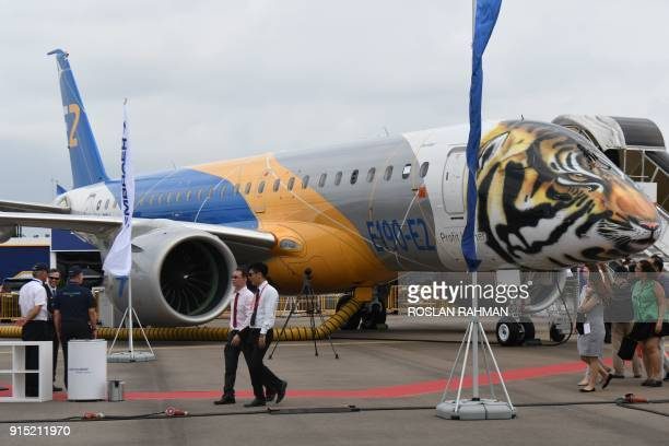 Embraer E190E2 private jets are displayed during the Singapore Airshow on February 7 2018 The Singapore Airshow Asia's largest aerospace and defence...