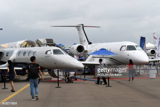 Embraer private jets are displayed during the Singapore Airshow on February 7 2018 The Singapore Airshow Asia's largest aerospace and defence event...