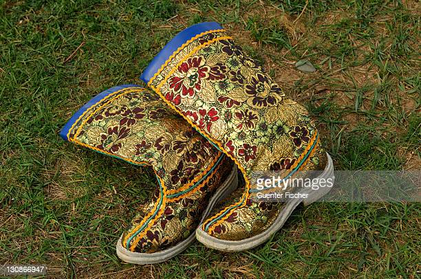 Embroidered boots lying in the grass, part of the Mongolian national costume, Ulan Bator or Ulaanbaatar, Mongolia, Asia