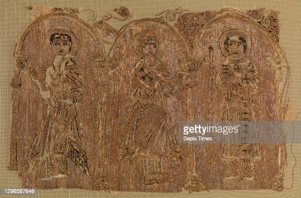 Embroidered Fragments with Three Saints, 12th century, Attributed to Egypt, Cotton; embroidered in gold thread and silk, 13.5 in. High 9.50 in. Wide...