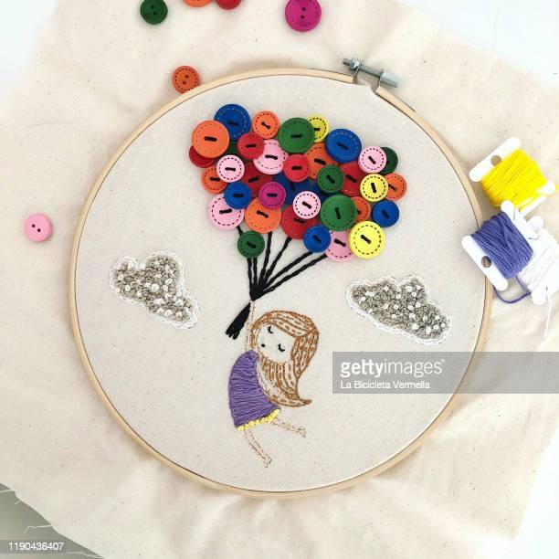 embroidered girl with balloons on frame - embroidery stock pictures, royalty-free photos & images