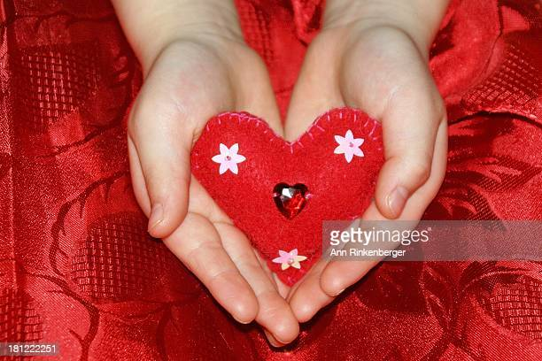 Embroidered Heart in a Child's Hands