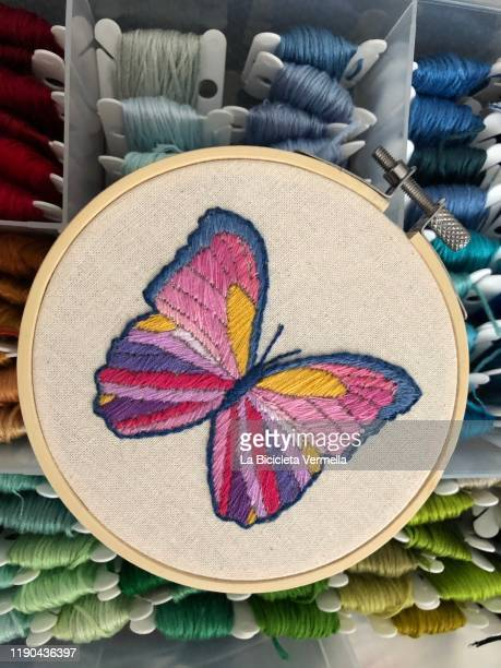 embroidered pink butterfly on frame - 刺繍 ストックフォトと画像