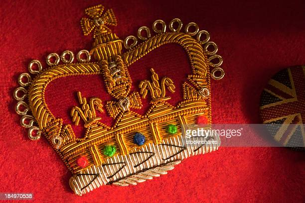 Embroidered royal crown on a red fabric