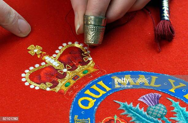 Embroiderer At Work At The Royal School Of Needlework At Hampton Court Palace Sewing In An Embroidered Coat Of Arms For The Woolsack On Which The New...