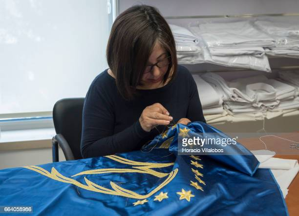 Embroiderer Otilia Oliveira works on a cape for a figure of the Virgin Mary at Consolata Missionaries shop on April 1 2017 in Fatima Portugal The...