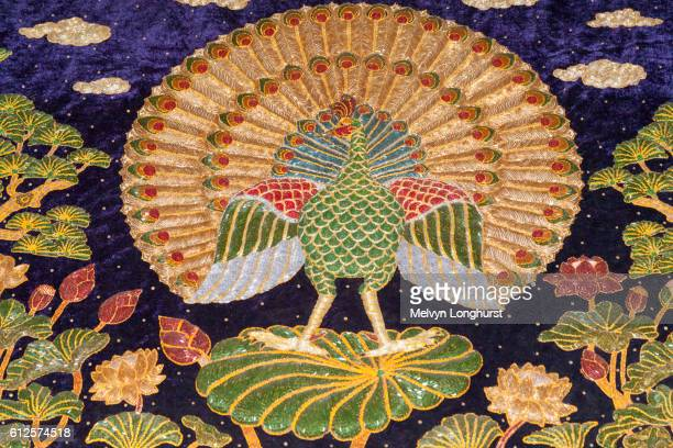 Embroidery depicting a peacock, Mandalay, Myanmar, (Burma)