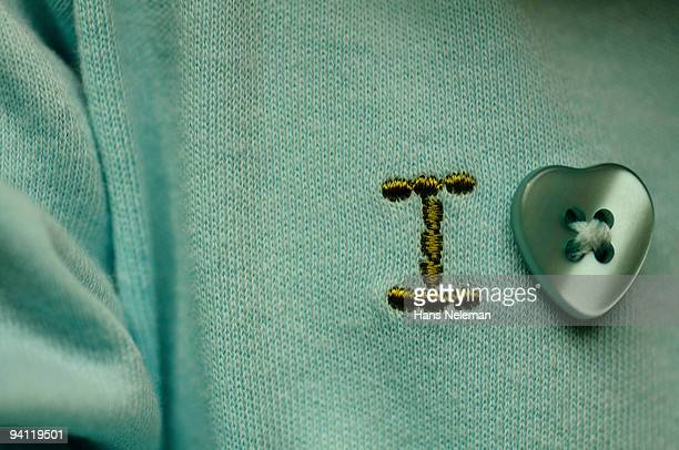Embroidery of I Love sign on a infants shirt