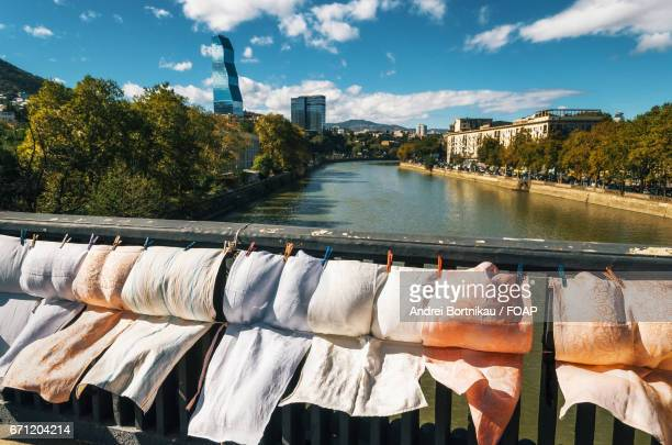 Embroidery, scarves and laundry for sale on the railing