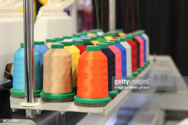 embroidery spools with thread - marie lafauci stock pictures, royalty-free photos & images