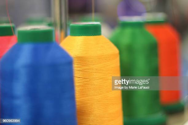 embroidery spools with thread - polyester stock photos and pictures