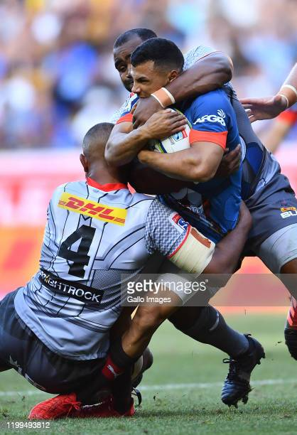 Embrose Papier of the Bulls tackled by Salmaan Moerat of the Stormers and Ali Vermaak of the Stormers during the Super Rugby match between DHL...