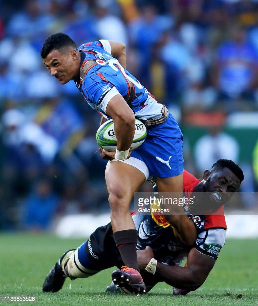 Embrose Papier of the Vodacom Bulls tackled by Siya Kolisi of DHL Stormers during the Super Rugby match between DHL Stormers and Vodacom Bulls at DHL...