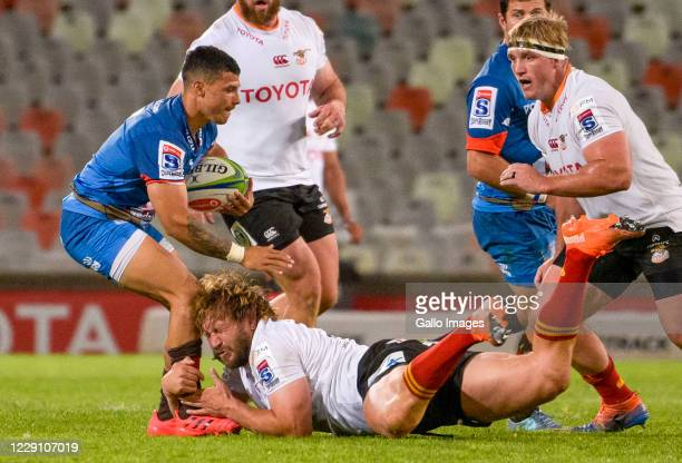 Embrose Papier of Vodacom Bulls tackled by Frans Steyn of Toyota Cheetahs during the Super Rugby Unlocked match between the Toyota Cheetahs and...