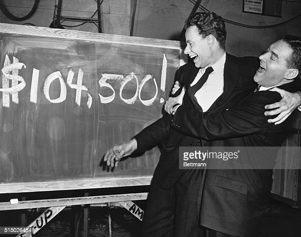 "Emcee Jack Barry bear hugs Charles Van Doren , Columbia instructor, after the latter won 104,500 on the TV quiz show ""Twenty-One"" tonight. That is..."