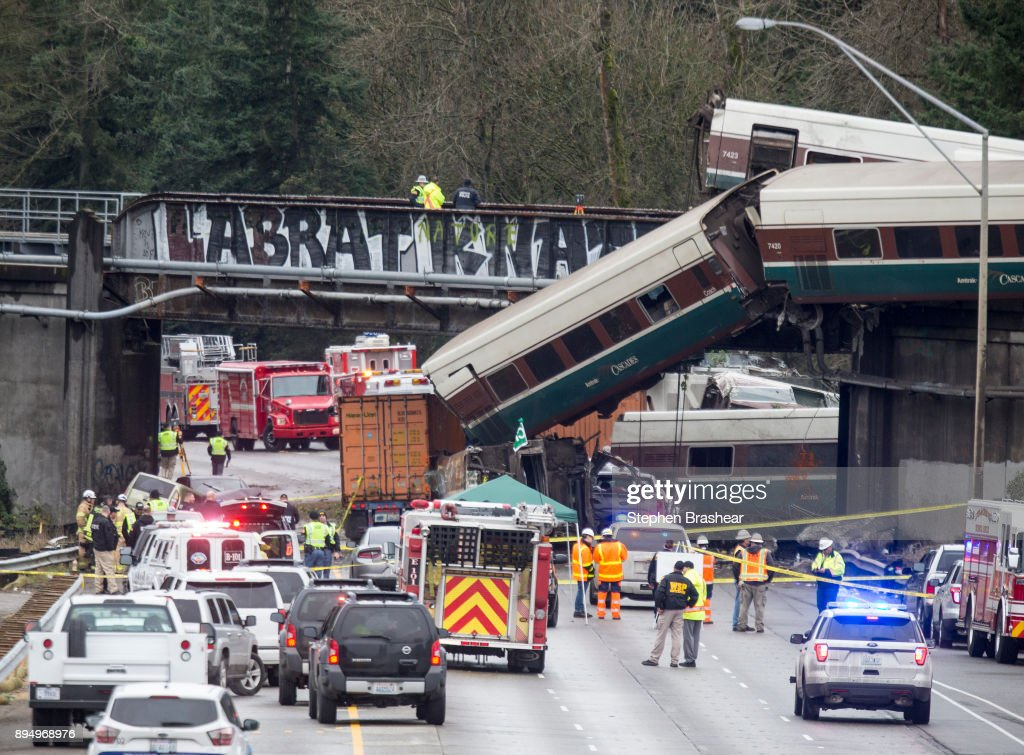 Amtrak Train Derailment South Of Tacoma, Washington Leaves Train Car Dangling Onto Highway : News Photo