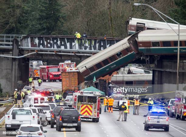 Emegency crews work at the scene of a Amtrak train derailment on December 18 2017 in DuPont Washington At least six people were killed when a...