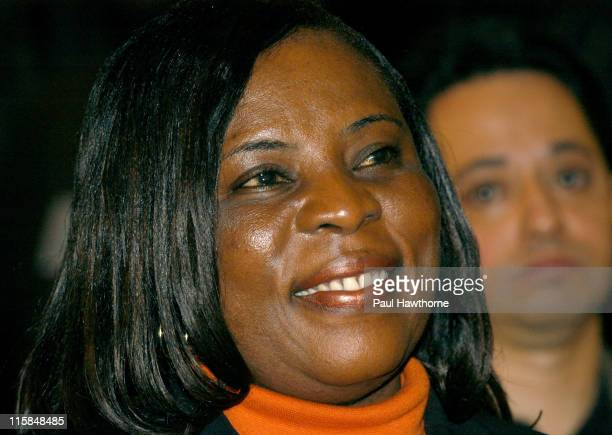 Emeila Adu listens during a news conference for her 14-year old son Freddy Adu, as he announces his multi year deal with Major league Soccer at...