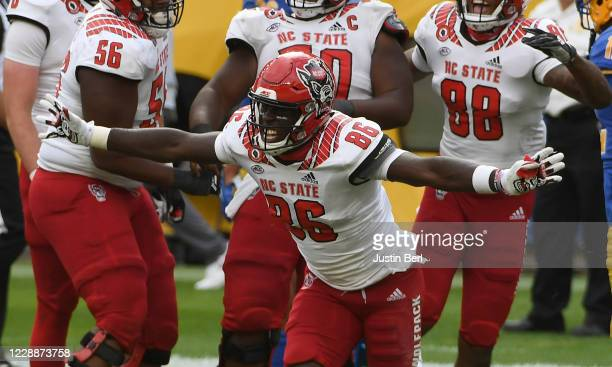 Emeka Emezie of the North Carolina State Wolfpack reacts after a catch for a 13yard touchdown reception in the fourth quarter during the game against...