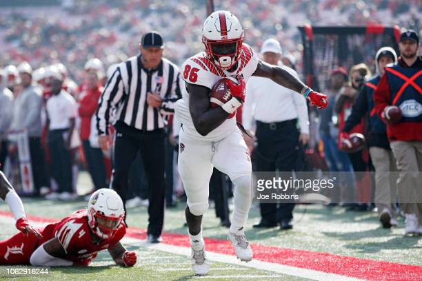 Emeka Emezie of the North Carolina State Wolfpack runs for the end zone with a 12yard touchdown reception against the Louisville Cardinals in the...