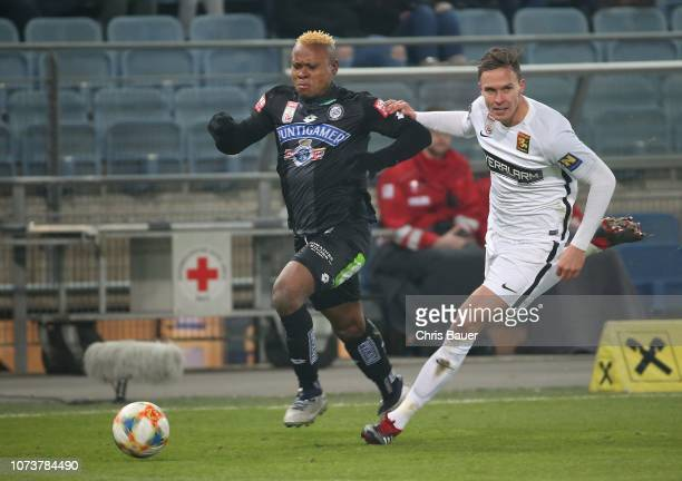 Emeka Eze of Sturm Graz and Bjarne Thoelke of Admira Wacker compete for the ball during the tipico Bundesliga match between SK Sturm Graz and FC...