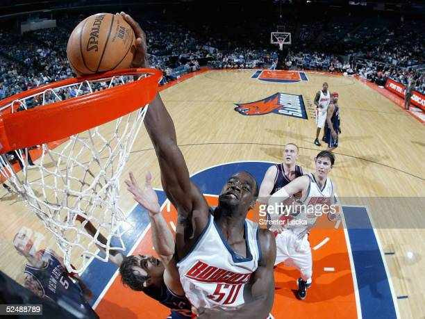 Emeka Okafor of the Charlotte Bobcats dunks the ball during the game against the New Jersey Nets March 28 2005 at the Charlotte Coliseum in Charlotte...