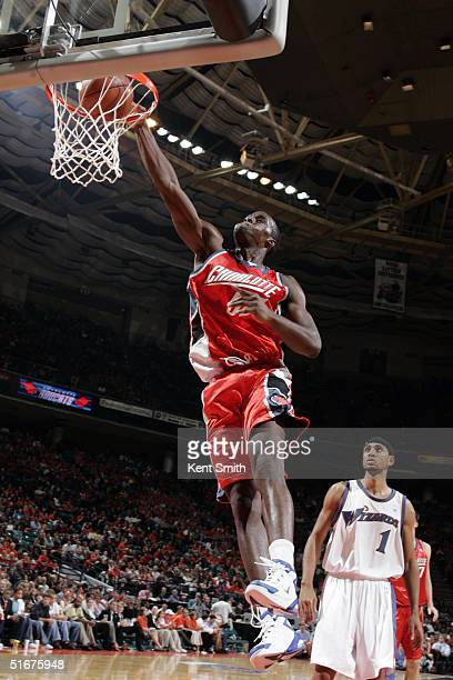Emeka Okafor of the Charlotte Bobcats dunks the ball Jared Jeffries of the Washington Wizards watches during the game on November 4 2004 at the...