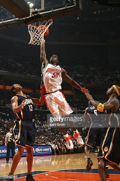 Emeka Okafor of the Charlotte Bobcats goes up for a dunk over the Indiana Pacers defense on November 1 2006 at the Charlotte Bobcats Arena in...