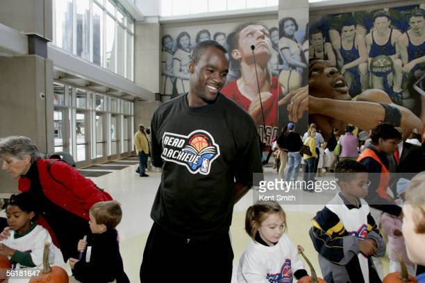 Emeka Okafor of the Charlotte Bobcats help the children decorate pumpkins during a Read to Achieve Event on October 25 2005 at the Charlotte Bobcats...