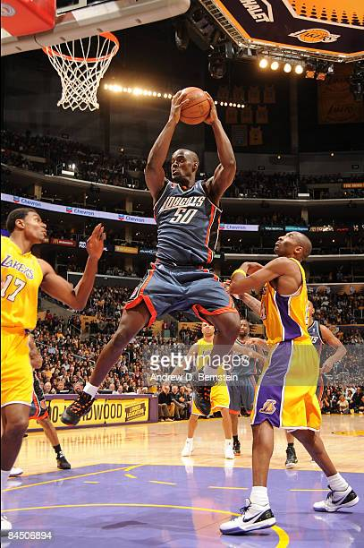 Emeka Okafor of the Charlotte Bobcats pulls down a rebound against the Los Angeles Lakers at Staples Center on January 27 2009 in Los Angeles...