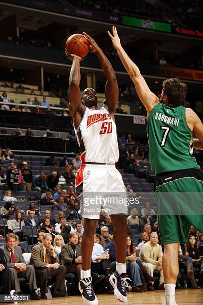 Emeka Okafor of the Charlotte Bobcats shoot a jump shot over Andrea Bargnani of the Toronto Raptors during the game at Time Warner Cable Arena on...