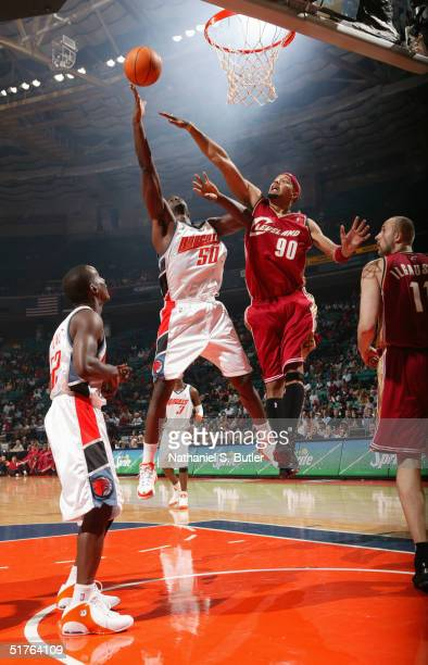 Emeka Okafor of the Charlotte Bobcats shoots over Drew Gooden of the Clevland Cavaliers November 18, 2004 at the Charlotte Coliseum in Charlotte,...
