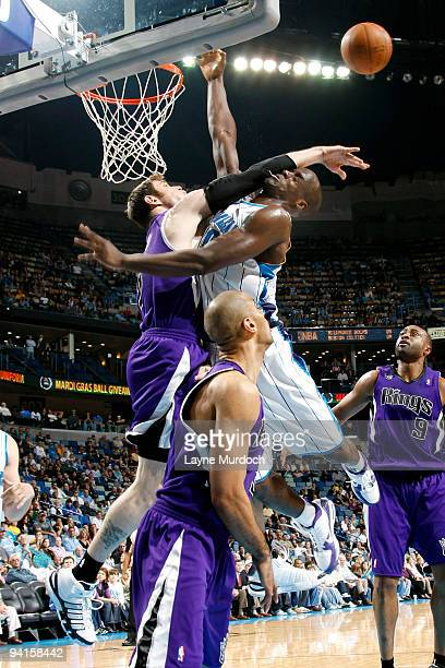 Emeka Okafor of the New Orleans Hornets attempts to shoot over Andres Nocioni of the Sacramento Kings on December 8 2009 at the New Orleans Arena in...
