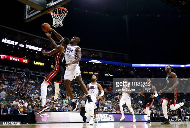 Emeka Okafor of the Philadelphia 76ers blocks a shot by DeAndre Liggins of the Miami Heat during the game at Sprint Center on October 13 2017 in...