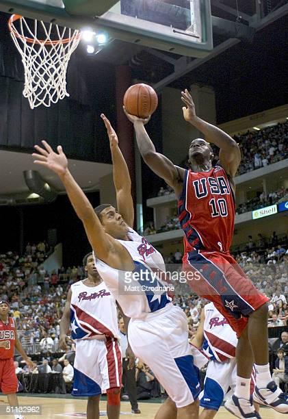 Emeka Okafor of the USA Basketball Men's Senior National Team drives against an unidentified player of the Puerto Rico Senior National Team during...