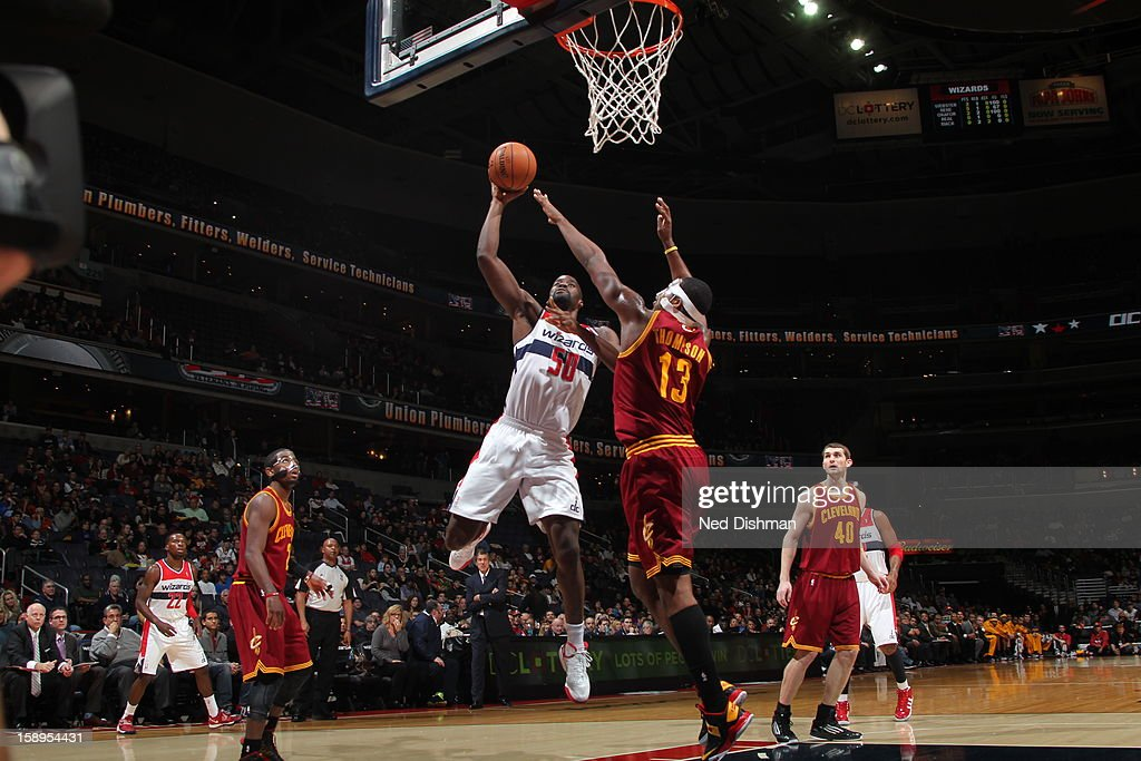 Emeka Okafor #50 of the Washington Wizards puts up a shot over Tristan Thompson #13 of the Cleveland Cavaliers at the Verizon Center on December 26, 2012 in Washington, DC.