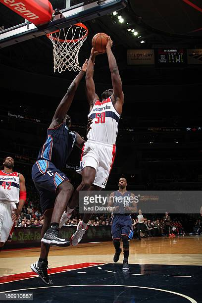 Emeka Okafor of the Washington Wizards shoots against DeSagana Diop of the Charlotte Bobcats during the game at the Verizon Center on November 24...