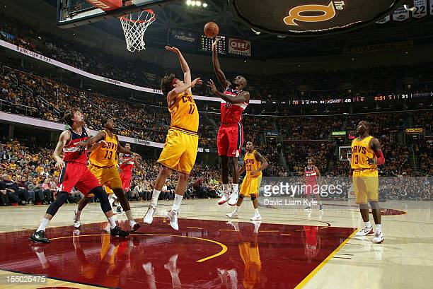 Emeka Okafor of the Washington Wizards tosses up the shot against Anderson Varejao of the Cleveland Cavaliers at The Quicken Loans Arena on October...