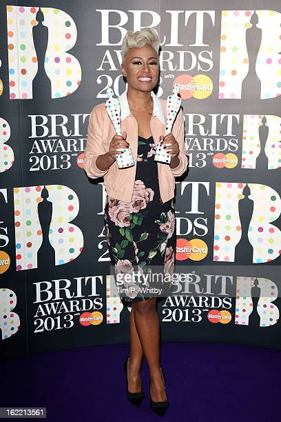Emeli Sandé poses with her British Female Solo Artist and Mastercard British Album of the Year awards in the press room at the Brit Awards 2013 at...