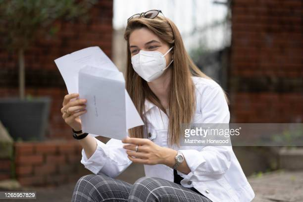 Emelia Ambrose wears a surgical mask while looking at her A Level results at Ffynone House School on August 13, 2020 in Swansea, Wales. Thousands of...