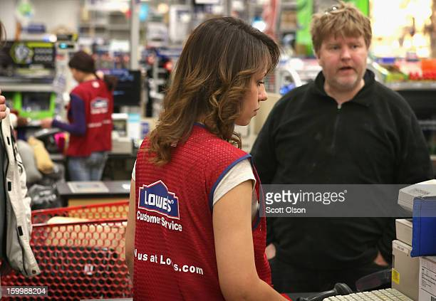 Emelisse Ortiz rings up a customer's purchase at a Lowe's home improvement store on January 24 2013 in Chicago Illinois Lowe's said they plan to hire...