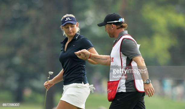 Emely K Pedersen of Denmark celebrates with her caddie after her birdie on the first green during the third round of the Meijer LPGA Classic golf...