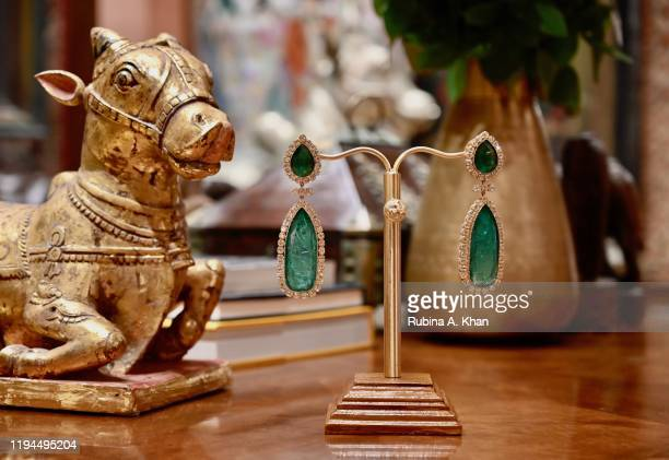 Emerald and diamond earrings, designed by Indian couturier and jewelry designer, Sabyasachi, at Sabyasachi Jewelry, his first flagship jewelry store...
